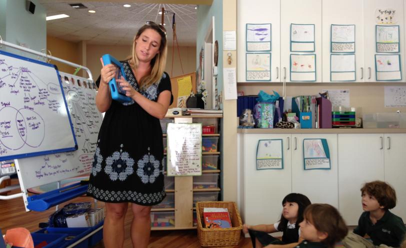 Teacher showing Samsung School App to students